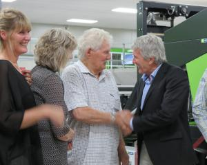 Orchard and packhouse owner Con van der Voort, of Ettrick, is congratulated by Minister of...