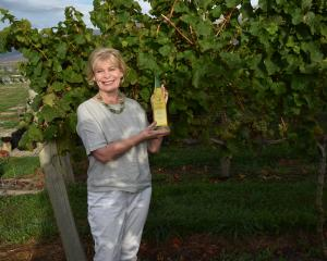 Janiene Bayliss, co-owner of Ata Mara Vineyard, shows off the champion riesling trophy won at the...