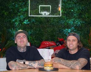 Burger sales have doubled in a week for Dunedin eatery Good Good co-owners Reece Turfus (left)...