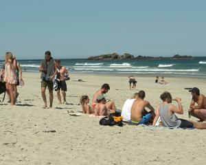 People enjoy the sun at Tomahawk Beach last month. Photo: Linda Robertson