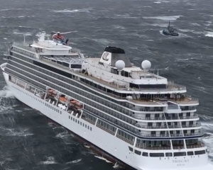 In this image taken from video made available by CHC helicopters, helicopters fly over the cruise...