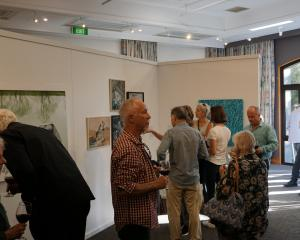 Members of the Wanaka community get their first glance at the Wai Water Wanaka exhibition. PHOTO:...