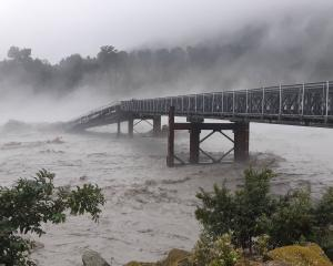 Much of the West Coast is cut off after a section of the Waiho River bridge was swept away. Photo...