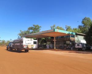 Rusty-red sandy soil fans across the forecourt of the Willare Roadhouse. Photos: Mike Yardley