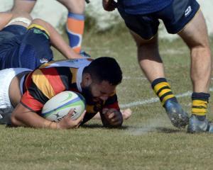 Zingari-Richmond co-captain Keenan Masina scores against Dunedin at Kettle Park on Saturday....