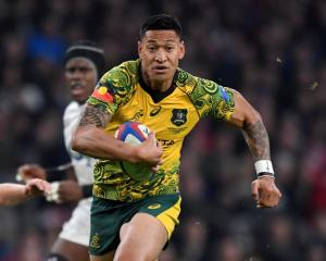 Israel Folau in action for the Wallabies against England last year. Photo: Reuters