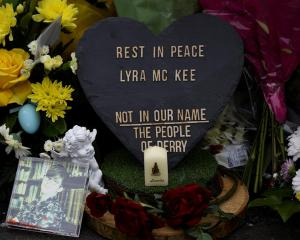 Tributes for Lyra McKee where she was shot dead, in Londonderry, Northern Ireland. Photo: Reuters