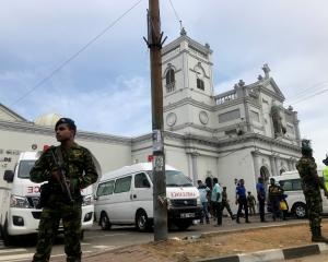Sri Lankan military officials stand guard in front of the St. Anthony's Shrine, Kochchikade...