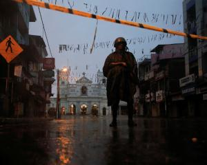 A soldier stands guard at St. Anthony's Shrine, days after a string of suicide bomb attacks on...