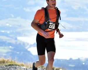 Hamish Elliott atop Mount Cargill yesterday during his Three Peaks Mountain Race win. Inset:...