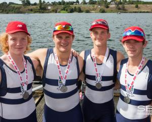 Teddy (left) with the silver medal-winning Otago Boys' High School quadruple sculls crew (from...