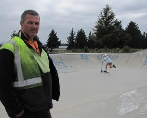 Alexandra BMX Club president Tony Nelson checks out graffiti at the Alexandra skatepark. Photo:...