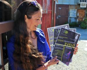 WoolOn Creative Fashion Event educational specialist Mary Hinsen looks over posters promoting...