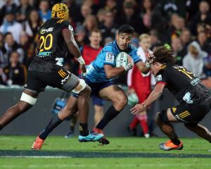 Blues Rieko Ioane is tackled during the round 9 Super Rugby match between the Chiefs and the...