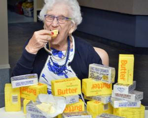 Dunedin centenarian Olga Janssen digs into the butter-covered scone she has craved for so many...