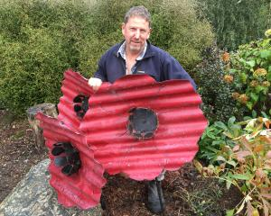 Poppies and a lone soldier, created by Richard Simpson, will be returned to one of his roadside...