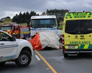 Emergency services at a septic trank truck versus car crash near Crichton, south of Milton on SH1...