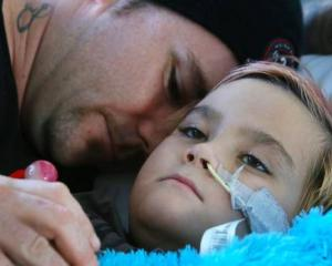 Fiazco Porter-Lewis with his dad Bevan Porter in Whangarei Hospital where Fiazco is recovering...