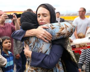 Prime Minister Jacinda Ardern hugs a mosque-goer at the Kilbirnie Mosque. Photo: Getty Images