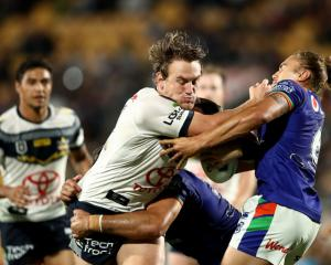 The Cowboys' Coen Hess fends off the Warriors' Chanel Harris-Tavita. Photo: Getty