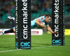Bernard Foley dives over to score for the Waratahs against the Rebels. Photo: Getty