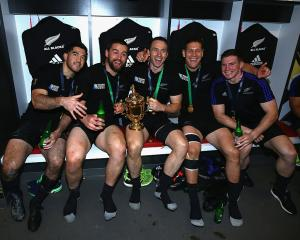 Nehe Milner-Skudder, Dane Coles, Ben Smith, and Tawera Kerr-Barlow of New Zealand pose with the...