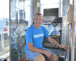 Runner Glenn Sutton inside his newly constructed heat box to prepare for the Badwater race....