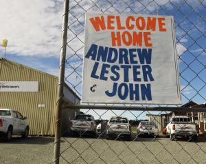 "A ""welcome home"" sign at Southern Lakes Helicopters for the trio who were involved in a..."
