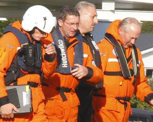 Otago Regional Rescue Helicopter paramedic Anthony Hoets with two rescued Southern Lakes...