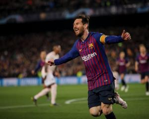 Lionel Messi celebrates one of two goals against Manchester United this morning. Photo: Getty Images