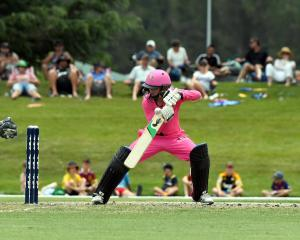 Northern Spirits opener Katie Gurrey guides the ball past Otago Sparks wicketkeeper Katey Martin...