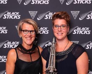 Gai (left) and Aimee Paardekooper with the Pakistan Trophy, awarded to their late husband and...