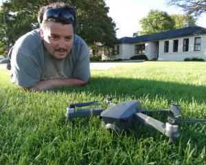 Oamaru's Damien McNamara, of Altitude Surveying, with his drone at Takaro Park near Oamaru...