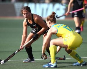 Olivia Shannon controls the ball for the Black Sticks during their loss to Australia yesterday....