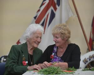 Barbara Pickering and daughter Joy Baker make posies for today's ceremony at the services section...