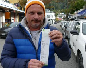 Arrowtown resident Glen Wallace and his fine for ``freedom camping'' on Rees St. PHOTO: GUY...