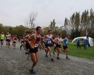 Cromwell runner Daniel Balchin won the men's open title after completing the 8km Lap of Lake...