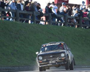 Norwegians Mads Ostberg and Torstein Eriksen handle a Ford Escort RS1800 in the Dunedin special...