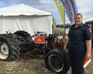 Fire and Emergency New Zealand fire risk management officer Kerri Pring displays a burnt-out...