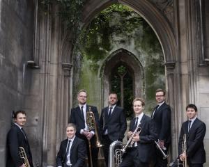 The members of Septura play trumpet, trombone and tuba.