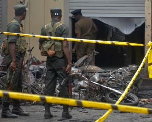 Sri Lankan military stand guard near the explosion site at a church in Batticaloa. Photo: Reuters