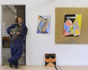 Imogen Taylor and Dusty settle into their new studio provided by the Frances Hodgkins Fellowship....