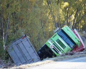 A Summerland freight truck in a ditch after it crashed at the bottom of Cluden Hill in the Lindis...