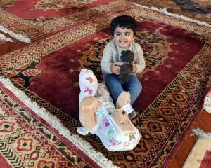 Playing with soft toys left outside the Al Huda mosque in Dunedin after last month's terror...