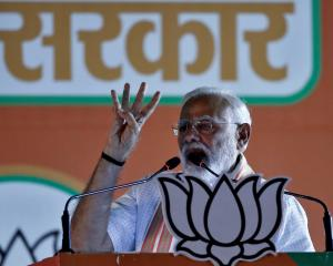 India's Prime Minister Narendra Modi addresses an election campaign rally at Ramlila ground in...