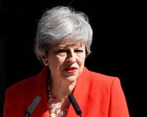 British Prime Minister Theresa May delivers a statement outside 10 Downing Street in London....