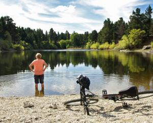 A cyclist takes a break along the Clutha Gold Trail. PHOTOS: TOURISM CENTRAL OTAGO