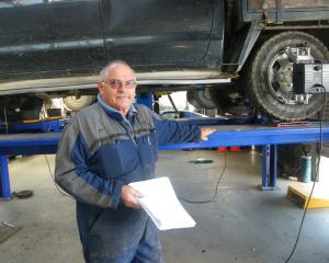 Omakau Auto Centre owner Tony Herbert had to send a 113-page document to comply with Immigration...