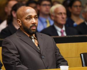 Keith Bush listens during a hearing to have his 1975 murder conviction vacated at Suffolk County...