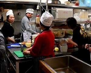 As on most nights, the Asian restaurant's kitchen is a hive of activity before diners arrive for...